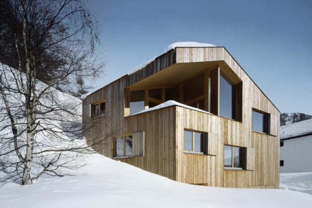 A wooden house in the snow