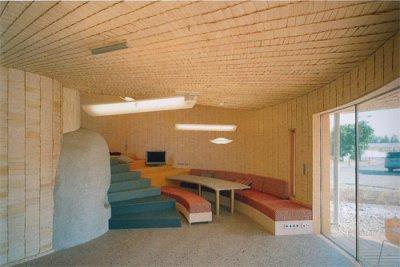 Unas casa hecha a base de peque as piezas de madera - Interior casas de madera ...